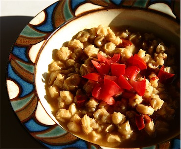 posole topped with chopped tomato