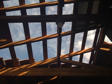 a view of the sky through old roof