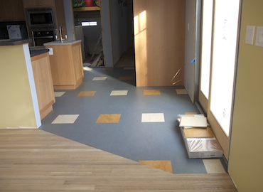 Marmoleum Click in kitchen, white oak in living-dining room
