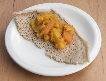 Ethiopian cabbage et al. stew on injera