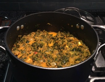 Saag paneer bubbling in pot