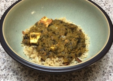Saag paneer over brown basmati